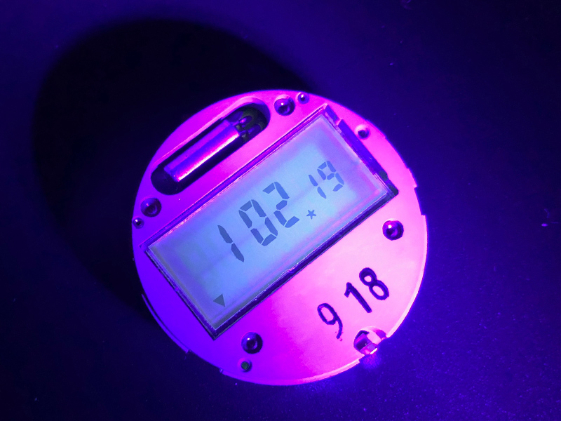 Tritium Stripes under UV Light